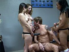 They make this dirty slut boy lube up their massive strapons with his spit, before they stick the huge sex toys in his ass. He chokes on one of the hot bitches dildos, while he takes another in his extremely tight asshole. They are in charge and these three chicks mean business.