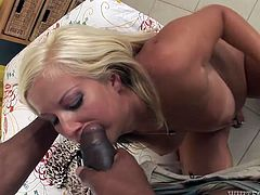 A blonde-haired babe with tanned skin and hairy cunt is eager to satisfy her lusty ebony partner. Watch the horny guy taking off her bikini and squeezing her lovely natural tits. See this seductive white bitch sucking cock passionately and riding it!