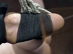 Are you a fan of brutal orgasmic pleasures? Click to watch slutty Penny, experiencing pain and pleasure all at once, under a merciless guy's dominance. See the naked bitch tied up strongly with ropes, while her feet are slapped and her nipples pinched hard...