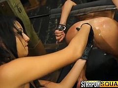 A naughty seductive lady with long black hair, has tied her bitchy slave with inescapable handcuffs. Brutal orgasmic pleasures are achieved with the help of kinky sex toys. Watch the naked slut sucking a black strap on, then fucked hard from behind. Enjoy the sexy details!