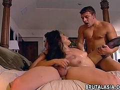 Asian slut is in bed wearing lacy stockings and she has a cock she is sucking on. Then, the second dude comes along and starts fucking her to create a real raw threesome.