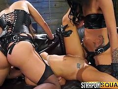 Two dominant ladies, wearing kinky black leather outfits and stockings, produce brutal orgasms to a naked slave, who has been bonded and blindfolded. See them removing her ball gag, just to stuff a big strap on down her throat... Watch this helpless lady fucked by horny lesbians!