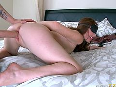 Are you into desperate wives, who're just craving for a hard dick? Click to watch Kassondra nude and blindfolded, while waiting patiently in bed. The redhead babe is eager to suck her lover's dick. See her pounded from behind!