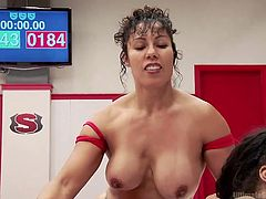 Slutty Izamar is confronting her busty rival, Yasmine, on the wrestling arena, until the referee anounces the lucky winner. See naughty Yasmine, wearing only a kinky strap on, which she uses to persuade her opponent to suck... Watch more sexy details!