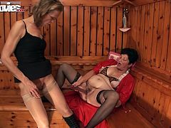 Marga pulls out her big strap-on after finger fucking and blowing Gundi.