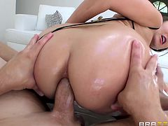 The sweet babe in the video is about to get wildly pounded by a horny guy. The man stuffs his hard dick in her crazy oiled ass, fucking her wildly from behind. Click to watch this sensual lady with small tits, getting really dirty!