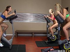 Karlie, Kenna and Blake love their gym time. They all train together, because they are all attracted to each other. Why wouldn't they? Their hot boobs are bursting out of their sports bras, when they get down on the floor and spread their pussies for each other, before kissing hard.