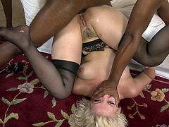 Daring blonde enjoys riding big black cocks in this interracial gang bang action