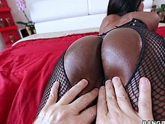 Dark skinned MILF in fishnet pantyhose puts her big black ass on display and then gets ehr mouth filled with hard white dick. She sucks lucky guys ivory cock like a pro!