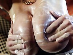 Ryan Madison gets seduced into fucking by Kelly Madison with gigantic breasts