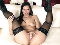 Delicious tart Eve Angel strips to give a close-up of her honeypot in solo scene