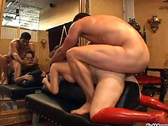 Tied up whore is fucked in front of the mirror in a torture room