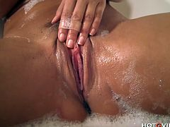 Lisa Ann, the mother of all MILFs, uses the Hotgvibe in the bathtub as a finger vibrator to stimulate her enormous tits and sensitive pussy until the sex toy gives her a sweet, satisfying orgasm.