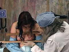 Cute brunette has her tits tortured by older male doctor with needles