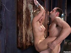 Slutty Ashley is about to get roughly fucked by a horny man, that tricked her to follow him home... The luscious blonde bitch had no idea he would drag her in the basement and use her in the dirtiest of ways. See the seducing milf, hands strongly tied with rope, banged hard from behind!