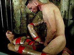 In the dungeon she is wrapped in plastic and fucked by her master