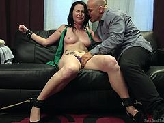 Derrick gets horny, as he squeezes a brunette slut's lovely tits. She has been handcuffed and has to obey the man's kinky wishes... Click to watch the bitchy lady, mouth fucked with no mercy! Enjoy the spicy details.