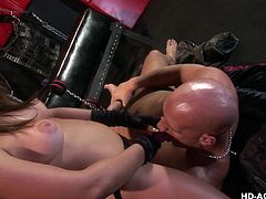 She makes him open up his legs nice and wide so she can see inside of his asshole. The beautiful slut has a whip and she is not afraid to use it on his ass. He has to just sit there and take it like a bitch. She shoves her strap on down his wet throat and slides it into his tight asshole for a hard fucking.