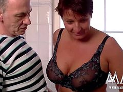 The busty cleaning lady gets fucked and cummed on in the bathroom.