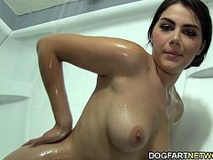 Valentina Nappi enters an adult bookstore in hopes that she'll have a fun time. She browses interracial porn DVDs and gets horny enough to start playing with her pussy in a viewing booth. However, her masturbation session soon gets interrupted by a black cock that comes through a hole in the wall.
