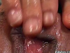 Perverted chick from Japan is fingering her very juicy closeup pussy