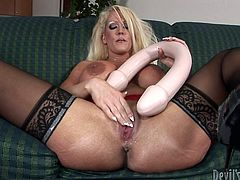 Do you enjoy seeing horny milfs masturbating? This long-haired slut loves playing dirty with kinky sex toys. Prepare to get your mind blown, as the busty lady has two giant dildos, a white and a black one, which she stuffs in her shaved appetizing cunt... Have fun watching!