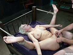 Busty Cherry can't utter a single word, as the kinky ball gag allows her only to whisper moans of pleasure mixed with pain, caused by the inescapable rope ties, which bond her strongly. Click to watch this naked babe, pounded hard by a dominant guy!
