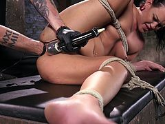 You would think damn near any chick would have a tight ass, even if her pussy is only slightly tight or even loose. Roxy's asshole might be tight, but it sure is easy to stretch! The rope-bound slut gets her backdoor fisted by her executor, while he applies a high-powered vibrator to her pussy. Amazing!
