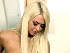 A sexy blonde peels off her skin tight pants and teases herself