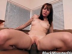 Redhead stretched out by a gigantic black dick
