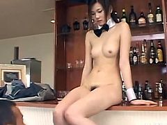 Wouldn't it be nice to have this beautiful Japanese bunny standing beside your bar. This cutie looks super hot in her lingerie. Her top comes off, so her man can lick those sweet nipples. The sexy slut's hairy snatch looks so inviting.