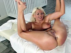 Sweet Layla can't get enough of interracial sex. A big black cock is such a turn-on for her. Oil is quite arousing for her as well. She gets herself oiled up really nice, to give her lover a titjob, before sucking his chocolate cock. He gets in her for a few strokes, before munching on her juicy pussy.