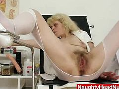 Older grandmother sits on gyno chair in a gyno medical room and spreads her hairy fuck hole with masturbates and gyno tools