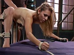 Uh-oh! Luna is tied up in the dungeon and can't get away (not that she really wants to). She's getting a high-powered vibrator against her pussy, making her soaking wet for her dominant. He easily slides inside her from behind and fucks her hard, fast, and deep.
