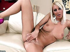 Blonde Pamela Blond with gigantic hooters cant stop toying her pussy