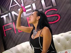 Lara Tinelli, beautiful Latin MILF, masturbates with the premium gspot vibrator at a sex expo in Barcelona until she experiences a gushing, squirting orgasm in public.