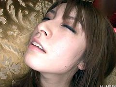 She is enjoying playing with her hitachi. Watch as she gets hornier and brings herself to orgasm. As she is masturbating, men are shooting hot spunk all over her pretty Japanese face. She loves getting sprayed with thick cum.