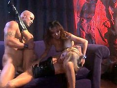 Two hot blondes with large fake tits are having group sex here. See them in various positions as they are having fun with one another here.
