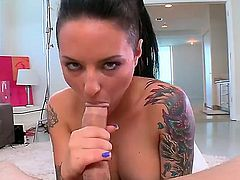 Christy Mack is placing a dick in her mouth and is then seen taking it up the ass on a sofa. She has a curvy body with some hot ink on it.