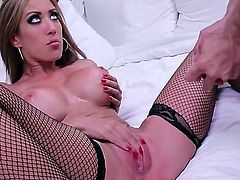 Capri Cavanni is a busty girl that is in a hotel room in her stockings, enjoying some pussy licking. Her large boobs are getting a lot of attention.