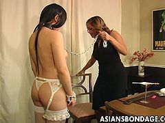 Asian slut in her lingerie is getting topples as the domina orders her to do stuff. Her ass is so ripe for a spank her sexy domina just had to spank her ass so she feels the painful sensation.