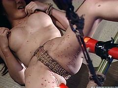 The master has devised a system, that automatically pours hot wax onto his slave's pussy and thighs. It is painful for her, but she is tightly bound in rope, so she can not get away. How much will this sexy slave be able to handle?