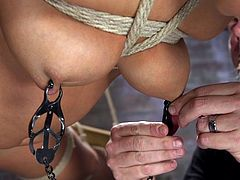 The master has this slut tied up and he is not very nice at all. He is cruel and mean. She has to endure as much pain as she can for him. He slaps her feet and hangs her from the ceiling in a humiliating way. Her nipples are clamped and her pussy is spread.