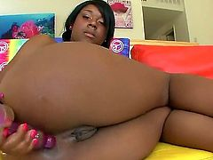 Megan Vaughn is an ebony chick that is using a dildo on her pussy. She has a huge ass and she likes to do insertion with a white guy.
