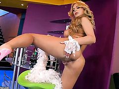 Blonde Dorothy Black poses seductively before masturbating