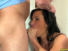 Milf with stunning fake tits bangs a dude in the shower