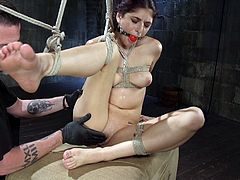 Even if Nikki wanted to get out of the fix she's in, it would be impossible unless her executor sets her free. She's gagged and securely bound, unable to articulate the torturous pleasure she's feeling. Her executor rubs her pussy, bringing her close to orgasm, then stopping, then starting again.