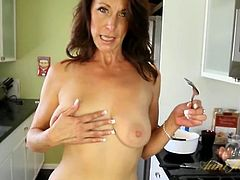 Housewife making pancakes and stripping in the kitchen