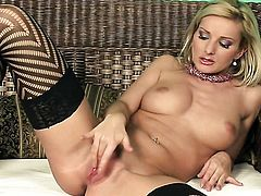 Vanessa Jordin plays with her neat twat after stripping
