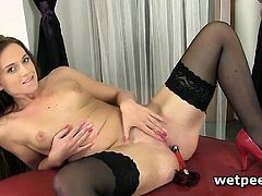 Stockinged hottie Naty Lee pees and squirts